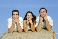 Group of friends on a straw bale Royalty Free Stock Image