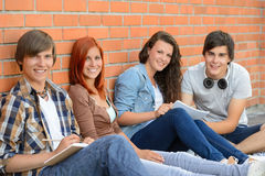 Group of friends students sitting in row Stock Photography