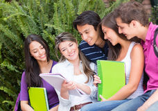 Group of friends studying Royalty Free Stock Photography