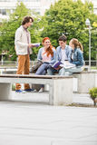 Group of friends studying together at college campus Stock Images