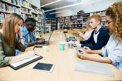 Group of friends studying in a university library. Portrait of group of friends studying in a university library royalty free stock images