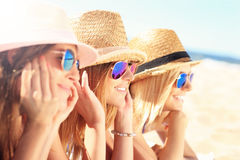 Group of friends sunbathing on the beach Stock Photography