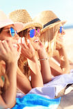 Group of friends sunbathing on the beach Royalty Free Stock Photography