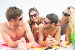 Group of friends in swimsuits Stock Images