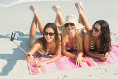 Group of friends in swimsuits taking a selfie Stock Images