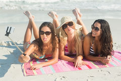Group of friends in swimsuits taking a selfie Royalty Free Stock Photo