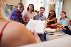 Group Of Friends Taking Part In Book Club At Home Stock Photography
