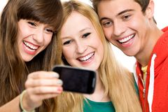 Group of friends taking photo of themselves Stock Photos
