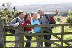 Group Of Friends Taking Photograph On Country Walk Royalty Free Stock Photos