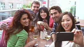 Group Of Friends Taking Photograph At Outdoor Rooftop Bar stock footage