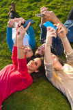 A group of friends taking photos with a smartphone Royalty Free Stock Photography