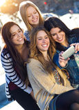 A group of friends taking photos with a smartphone Royalty Free Stock Photos