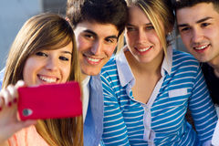Group of friends taking photos with a smartphone Royalty Free Stock Photos