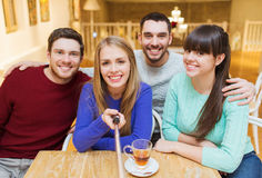Group of friends taking picture with selfie stick Stock Image