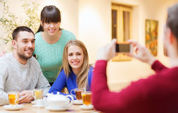 Group of friends taking picture with smartphone Royalty Free Stock Photo