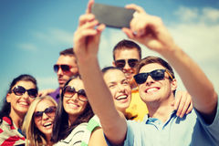 Group of friends taking picture with smartphone Stock Photo