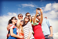 Group of friends taking picture with smartphone Royalty Free Stock Photos