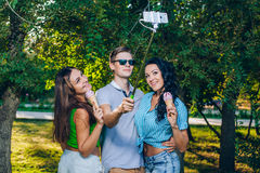 Group of friends taking picture themselves with Royalty Free Stock Images