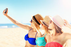 Group of friends taking selfie on the beach Royalty Free Stock Photography