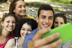 Group of Friends Taking Selfie. At Park Royalty Free Stock Photo