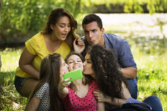 Group of Friends Taking Selfie. At Park Royalty Free Stock Images