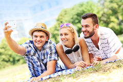 Group of friends taking selfie in the park Stock Photography