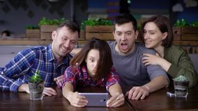 Group of friends taking selfie in restaurant stock video