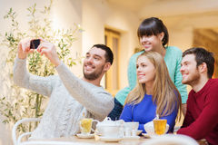 Group of friends taking selfie with smartphone Stock Photo