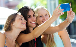 Group of friends taking selfie in the street. Royalty Free Stock Images
