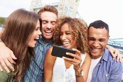 Group Of Friends Taking Selfie By Tower Bridge In London Royalty Free Stock Photo