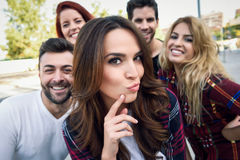 Group of friends taking selfie in urban background Royalty Free Stock Photo