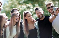 Group of friends taking selfies in the Park. People and technology royalty free stock images