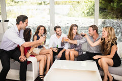 Group of friends talking and having drinks Stock Photography