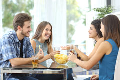 Group of friends talking at home Royalty Free Stock Images