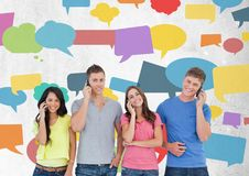 Group of friends talking on phones in front of colorful chat bubbles. Digital composite of Group of friends talking on phones in front of colorful chat bubbles Stock Image