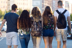A group of friends talking in the street after class Stock Photo