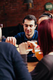Group Of Friends In Tavern Stock Photography