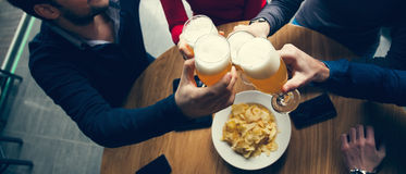 Group Of Friends In Tavern Royalty Free Stock Images