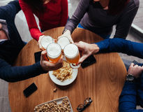 Group Of Friends In Tavern Stock Image