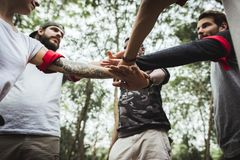 Group of friends team up for activity Stock Image
