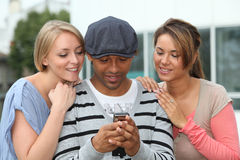 Group of friends with telephone Royalty Free Stock Photo