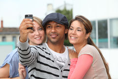 Group of friends with telephone Stock Photography