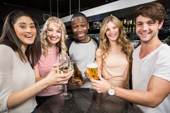 Group of friends toasting with beer and wine Stock Image