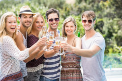 Group of friends toasting champagne glasses. Group of happy friends toasting champagne glasses outdoors Royalty Free Stock Photo