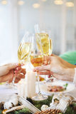 Group of friends toasting with champagne while having Christmas Royalty Free Stock Images