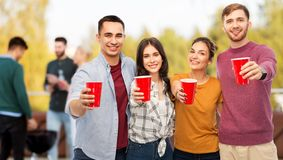 Group of friends toasting drinks at rooftop party stock images