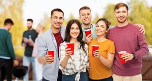Group of friends toasting drinks at rooftop party royalty free stock photos
