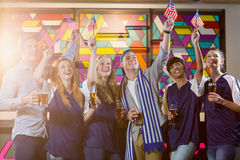 Group of friends toasting glass of beer in party. Group of smiling friends toasting glass of beer in party at bar stock photos