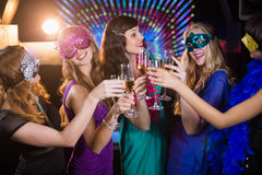 Group of friends toasting glass of champagne. Group of smiling friends toasting glass of champagne in bar stock photography