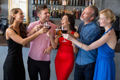 Group of friends toasting glasses of beer and wine. In restaurant Royalty Free Stock Photos